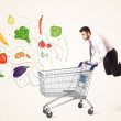 Businessman with shopping cart with vegetables — Stock Photo #60578033
