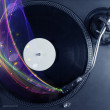 Turntable playing vinyl with glowing abstract lines — Stock Photo #60579315