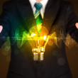 Businessman holding light bulb — Stock Photo #60580593
