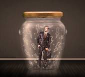 Businessman inside a glass jar with lightning drawings concept — Stock Photo