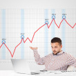Businessman calculating stock market with rising graph in the ba — Stock Photo #61604955