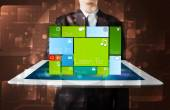 Businessman holding a tablet with modern software operational sy — Stock Photo