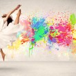Happy teenager jumping with colorful ink splatter on urban backg — Stock Photo #61696457