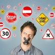 Young man with glued mouth and traffic signals — Stock Photo #61699901