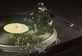 Turntable playing classical music with icon drawn instruments  — Stock Photo