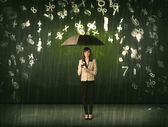 Businesswoman standing with umbrella and 3d numbers raining conc — Stock Photo