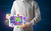 Zakenman houden een tablet met moderne kleurrijke apps en pictogrammen — Stockfoto