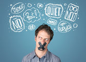 Young man with glued mouth and thought clouds — Stock Photo
