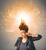 Young woman with energetic exploding red hair  — Stock Photo