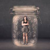 Business woman captured in glass jar with hand drawn media icons — Stock Photo
