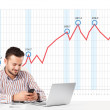 Businessman calculating stock market with rising graph in the ba — Stock Photo #62751501