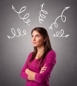 Young woman thinking with arrows overhead — Stock Photo