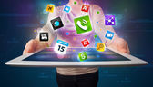 Lady holding a tablet with modern colorful apps and icons — Stock Photo