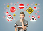 Young woman with glued mouth and traffic signals — Stock Photo