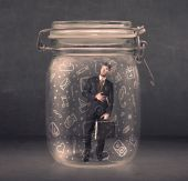 Business man captured in glass jar with hand drawn media icons c — Stock Photo