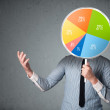 Businessman holding a pie chart — Stock Photo #63354521