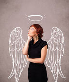 Cute girl with angel illustrated wings — Stockfoto