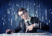 Hacker decoding information from futuristic network technology — ストック写真
