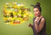 Cute girl blowing colourful glowing memory picture concept — Stock Photo