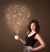Businesswoman holding a white cup with social media icons — Stock Photo