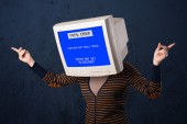 Person with a monitor head and fatal error blue screen on the di — Stock Photo