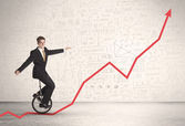 Business parson riding unicycle on an uprising red arrow  — Stock Photo