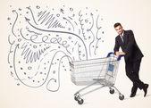 Businessman with shopping cart — ストック写真