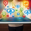 Girl presenting a tablet with colorful social icons and signs — Stock Photo #65135047