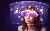 Young woman looking at futuristic social network map — Stock Photo