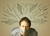 Young man with glued mouth and curly lines — Stock Photo