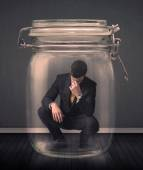 Businessman trapped into a glass jar concept — Stock Photo