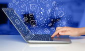 Laptop computer wtih hand drawn icons and symbols — Stock Photo