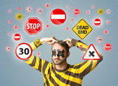 Young man with glued eye and traffic signals — Stock Photo