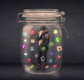 Businessman captured in a glass jar with colourful app icons con — Stock Photo