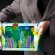 Young person showing tablet with hand drawn cityscape — Stock Photo #67022543