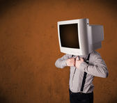 Business man with a monitor on his head and brown empty space — Stockfoto