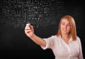 Young woman sketching and calculating thoughts — Stockfoto