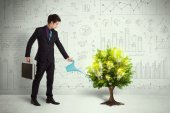 Business man pouring water on lightbulb growing tree — Stock Photo