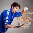 Handsome man holding laptop with graphs and statistics — Stock Photo #67680707