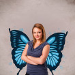 Young girl with butterfly blue illustration on the back — Stock Photo #68337777