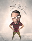 Big head person with drawn hammers — Stock Photo