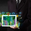 Young person showing tablet with hand drawn cityscape — Stock Photo #69051725
