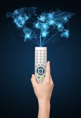 Hand with remote control, social media concept — Stock Photo