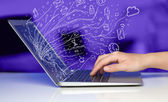 Man pressing notebook laptop computer with doodle icon cloud sym — Stock Photo