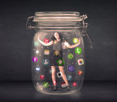 Businesswoman captured in a glass jar with colourful app icons c — Stock Photo