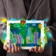 Young person showing tablet with hand drawn cityscape — Stock Photo #69674677