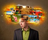 Man with colorful glowing photo memories concept — Stock Photo