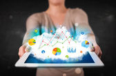 Person holding a touchpad with cloud technology and charts — Stock Photo
