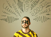 Young man with glued eye and curly lines — Stock Photo