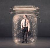 Business man captured in glass jar with hand drawn media icons c — Stockfoto